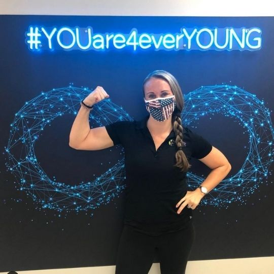 Patient at Selfie Wall for Forever Young Aesthetics in Tampa FL